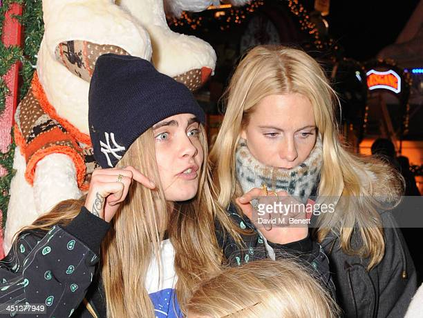 Cara Delevingne and Poppy Delevingne attends the Hyde Park Winter Wonderland VIP opening on November 21 2013 in London England