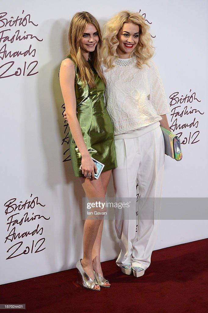 Cara Delevingne and Rita Ora pose in the awards room at the British Fashion Awards 2012 at The Savoy Hotel on November 27, 2012 in London, England.