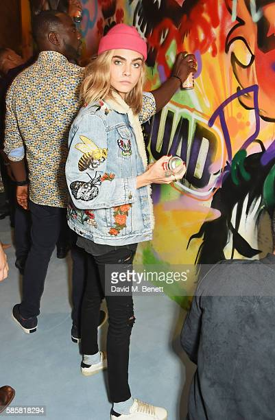 """Cara Delevingne and the cast of """"Suicide Squad"""" put the finishing touches on Graffiti artist Ryan Meades' mural ahead of tomorrow's film release on..."""