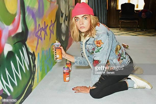 Cara Delevingne and the cast of 'Suicide Squad' put the finishing touches on Graffiti artist Ryan Meades' mural ahead of tomorrow's film release on...