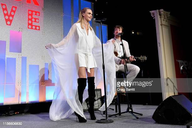 Cara Delevingne and Will Heard perform onstage during TrevorLIVE NY 2019 at Cipriani Wall Street on June 17 2019 in New York City