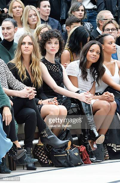 Cara Delevingne Annie Clark and Naomie Harris attend the Burberry Womenswear Spring/Summer 2016 show during London Fashion Week at Kensington Gardens...