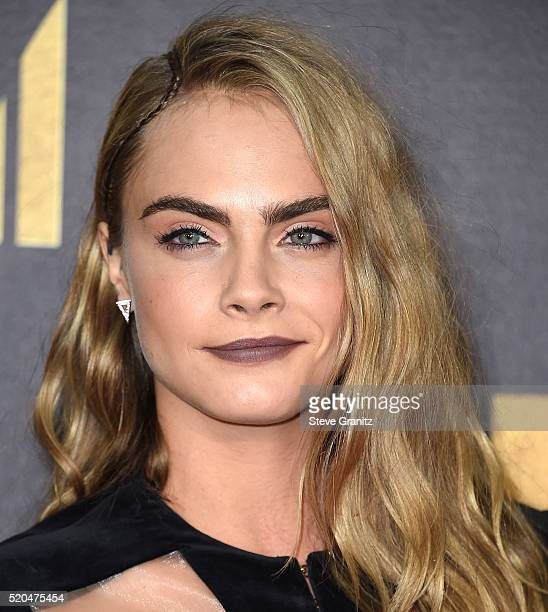 Cara Delevingne arrives at the 2016 MTV Movie Awards at Warner Bros Studios on April 9 2016 in Burbank California