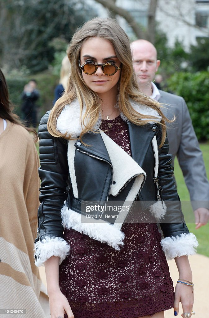 Cara Delevingne arrives at the Burberry Prorsum AW 2015 during London Fashion Week at Kensington Gardens on February 23, 2015 in London, England.
