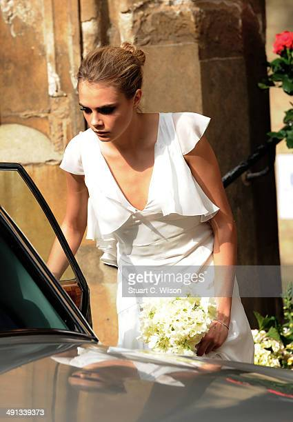 Cara Delevingne arrives for Poppy Delevingne's wedding at St Pauls Knightsbridge on May 16 2014 in London England
