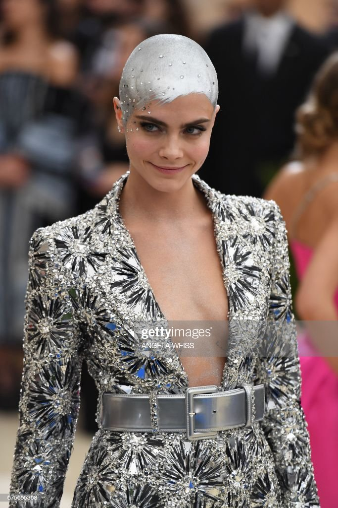 TOPSHOT - Cara Delevingne arrives for the Costume Institute Benefit on May 1, 2017 at the Metropolitan Museum of Art in New York. /