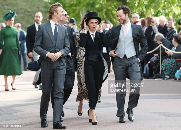 TOPSHOT Cara Delevingne arrives with her brotherinlaw James Cook and US journalist Derek Blasberg to attend the wedding of Britain's Princess Eugenie...