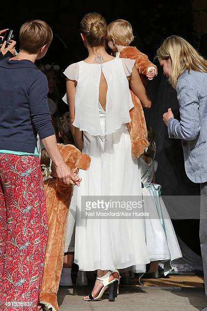 Cara Delevingne arriving at the wedding of Poppy Delevingne and James Cook on May 16 2014 in London England