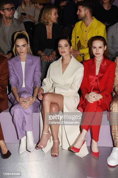 Cara Delevingne Ashley Benson and Madelaine Petsch attend the Boss fashion show on February 23 2020 in Milan Italy