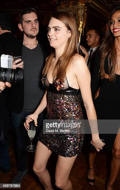 Cara Delevingne attends a party in celebration of Edward Enninful in The Oscar Wilde Bar Hotel Cafe Royal on December 1 2014 in London England