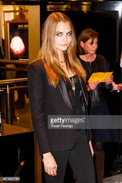 Cara Delevingne attends a photocall for the YSL Beaute: YSL Loves Your Lips launch at Selfridges on January 20, 2015 in London, England.