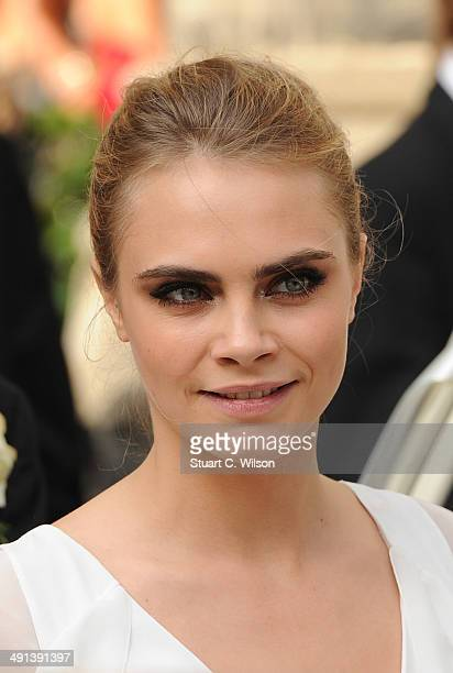 Cara Delevingne attends her sister Poppy Delevingne's marriage to James Cook at St Paul's Church Knightsbridge on May 16 2014 in London England