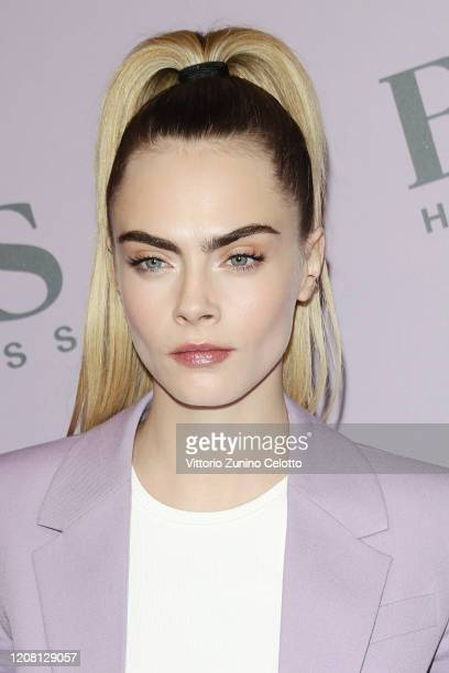 Cara Delevingne attends the BOSS fashion show during the Milan Fashion Week Fall/Winter 2020 2021 on February 23 2020 in Milan Italy