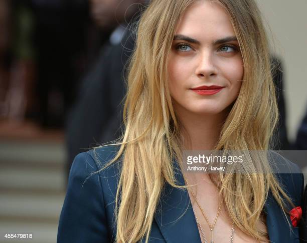 Cara Delevingne attends the Burberry Prorsum show during London Fashion Week Spring Summer 2015 on September 15 2014 in London England
