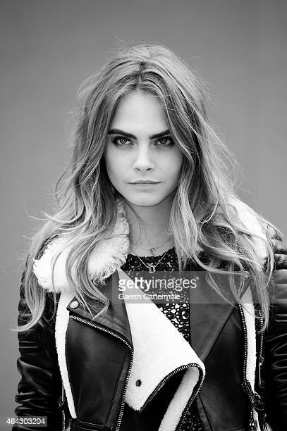 Cara Delevingne attends the Burberry Prorsum show during London Fashion Week Fall/Winter 2015/16 at Perk's Field on February 23 2015 in London England