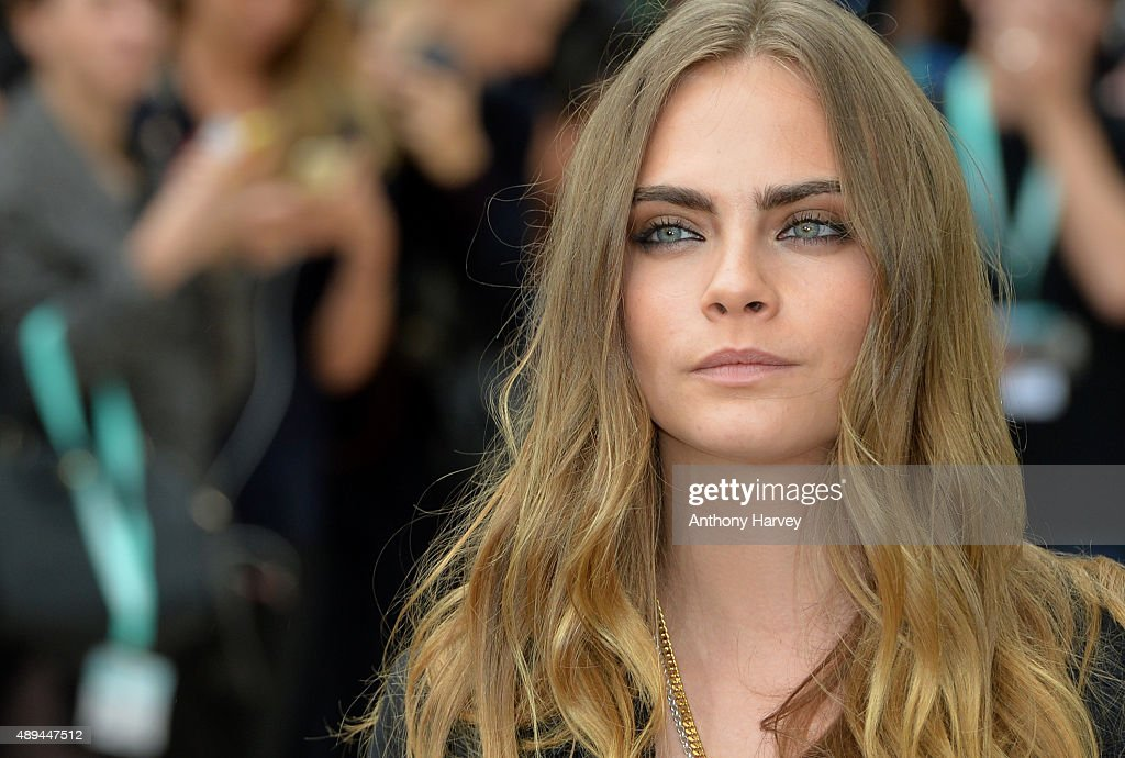 Cara Delevingne attends the Burberry Prorsum show during London Fashion Week Spring/Summer 2016/17 on September 21, 2015 in London, England.