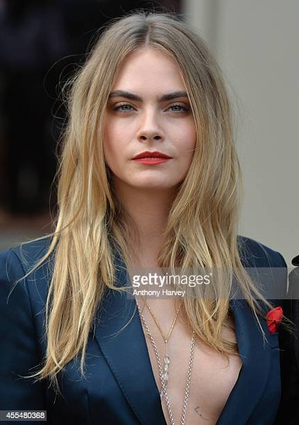 Cara Delevingne attends the Burberry Prorsum show Womens wear 2015 during the London Fashion Weekk SS15 on September 15 2014 in London England