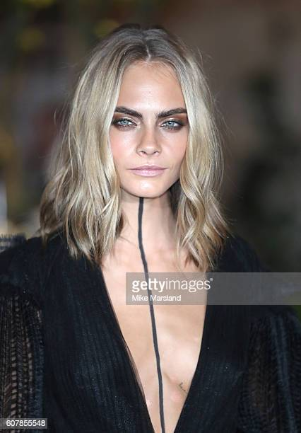 Cara Delevingne attends the Burberry show during London Fashion Week Spring/Summer collections 2016/2017 on September 19 2016 in London United Kingdom