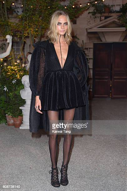 Cara Delevingne attends the Burberry show during London Fashion Week Spring/Summer collections 2016/2017 at Makers House on September 19 2016 in...