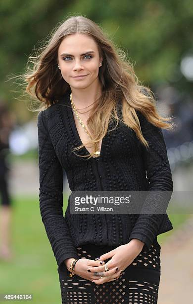 Cara Delevingne attends the Burberry Womenswear Spring/Summer 2016 show during London Fashion Week at Kensington Gardens on September 21 2015 in...