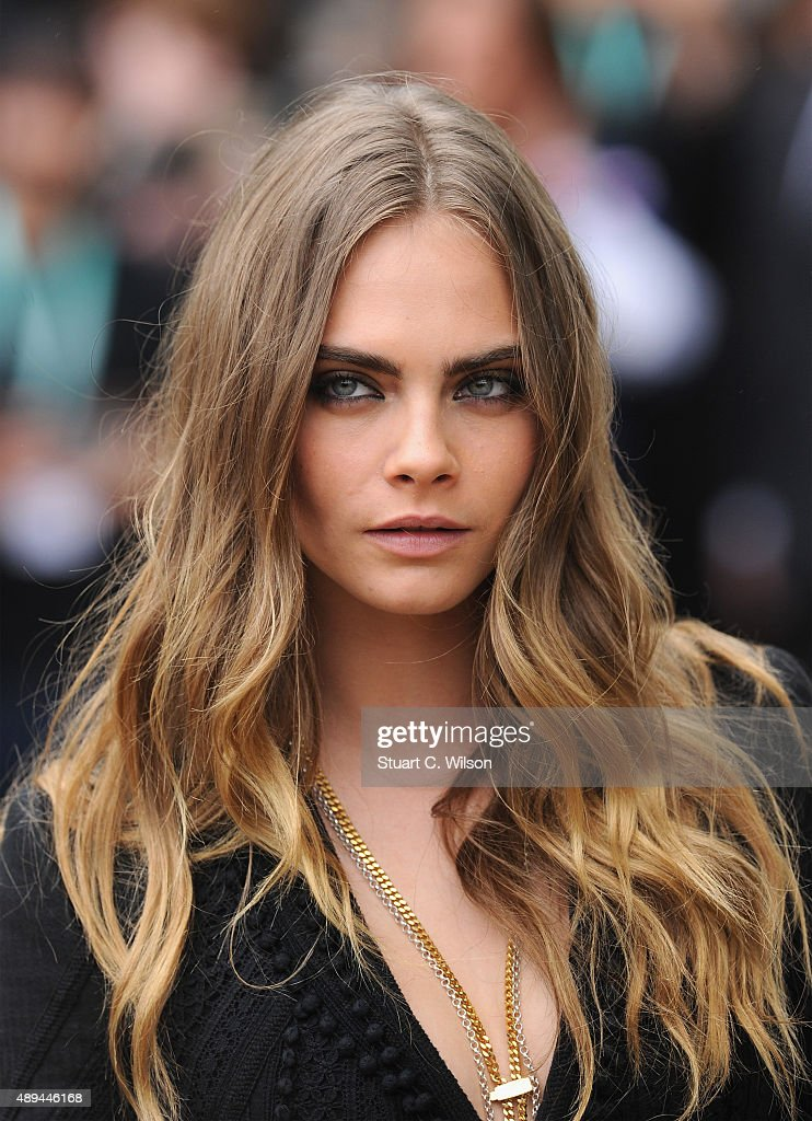 Cara Delevingne attends the Burberry Womenswear Spring/Summer 2016 show during London Fashion Week at Kensington Gardens on September 21, 2015 in London, England.