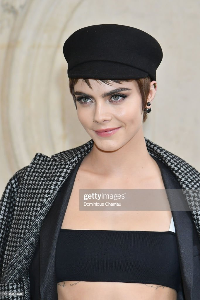 Cara Delevingne attends the Christian Dior show as part of the Paris Fashion Week Womenswear Fall/Winter 2018/2019 on February 27, 2018 in Paris, France.