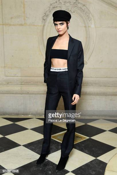 Cara Delevingne attends the Christian Dior show as part of the Paris Fashion Week Womenswear Fall/Winter 2018/2019 on February 27 2018 in Paris France