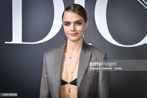 Cara Delevingne attends the Dior Homme Menswear Fall/Winter 20202021 show as part of Paris Fashion Week on January 17 2020 in Paris France