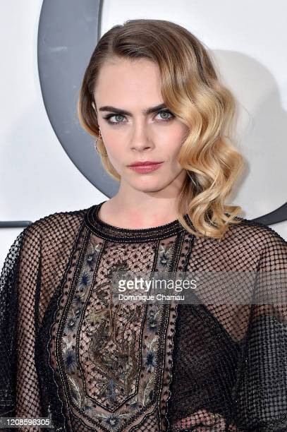 Cara Delevingne attends the Dior show as part of the Paris Fashion Week Womenswear Fall/Winter 2020/2021 on February 25 2020 in Paris France