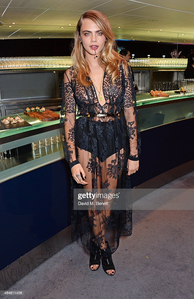 Cara Delevingne attends the GQ Men Of The Year awards in association with Hugo Boss at The Royal Opera House on September 2, 2014 in London, England.