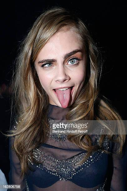 Cara Delevingne attends the HM Fashion Show Fall/Winter 2013 ReadytoWear after party as part of Paris Fashion Week on February 27 2013 in Paris France