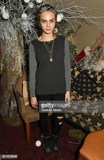 Cara Delevingne attends the LOVE Christmas party at George on December 18 2015 in London England