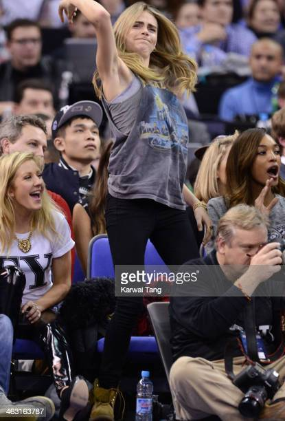 Cara Delevingne attends the NBA Live basketball match between the Brooklyn Nets and Atlanta Hawks at the 02 Arena on January 16 2014 in London England