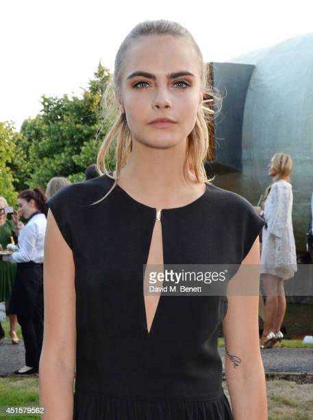 Cara Delevingne attends The Serpentine Gallery Summer Party cohosted by Brioni at The Serpentine Gallery on July 1 2014 in London England