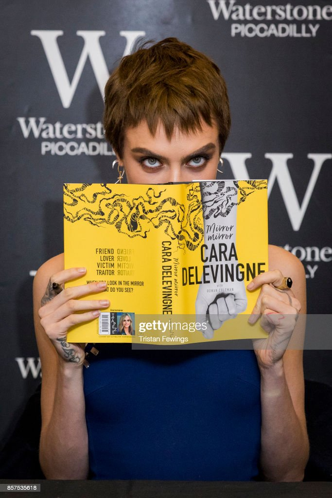 Cara Delevingne attends the signing of her debut Young Adult novel 'Mirror, Mirror' at Waterstones Piccadilly on October 4, 2017 in London, England.