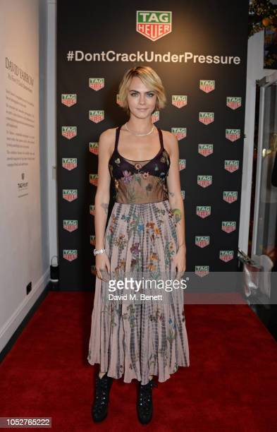 Cara Delevingne attends the TAG Heuer auction featuring unseen art work from the Don't Crack Under Pressure Campaign in association with Cara...
