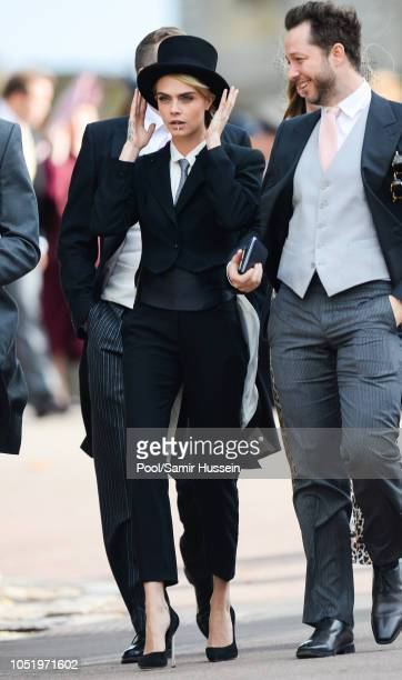 Cara Delevingne attends the wedding of Princess Eugenie of York and Jack Brooksbank at St George's Chapel in Windsor Castle on October 12 2018 in...