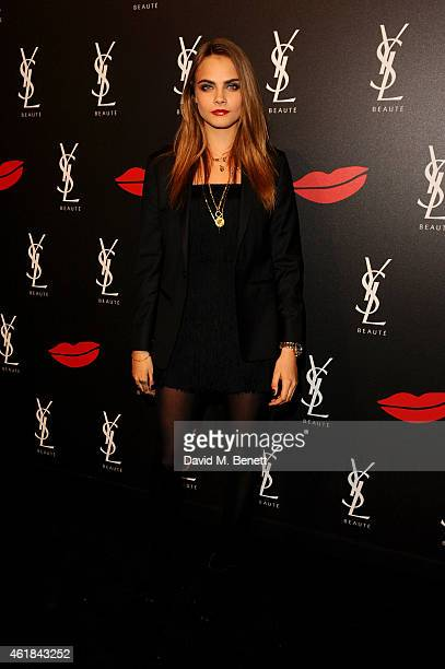Cara Delevingne attends the YSL Beaute Makeup Celebration 'YSL Loves Your Lips' in the presence of Cara Delevingne at The Boiler House, The Old...