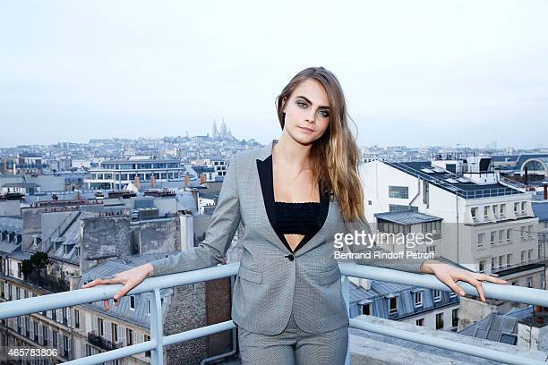 Cara Delevingne attends the Yves Saint Laurent Beauty event at Galeries Lafayette on March 10 2015 in Paris France