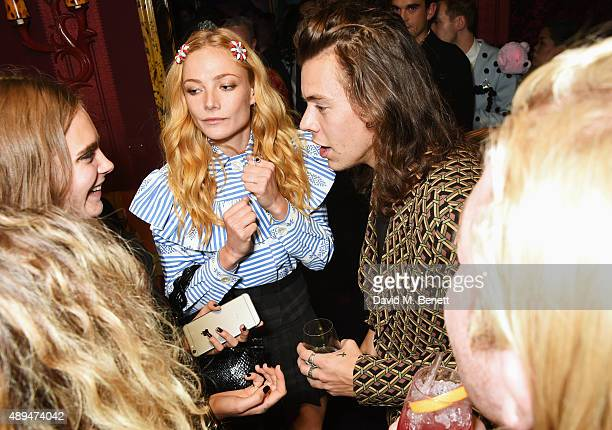 Cara Delevingne Clara Paget and Harry Styles attend the Love Magazine miu miu London Fashion Week party at Loulou's on September 21 2015 in London...