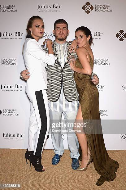 Cara Delevingne Eli Mizrahi and Selena Gomez attend the Leonardo Dicaprio Gala at Domaine Bertaud Belieu on July 23 2014 in SaintTropez France