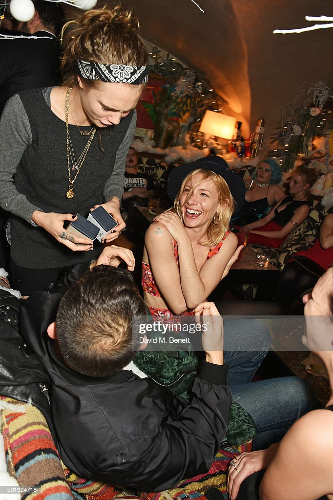Cara Delevingne, Jonathan Saunders, Sienna Miller and Katie Grand attend the LOVE Christmas party at George on December 18, 2015 in London, England.