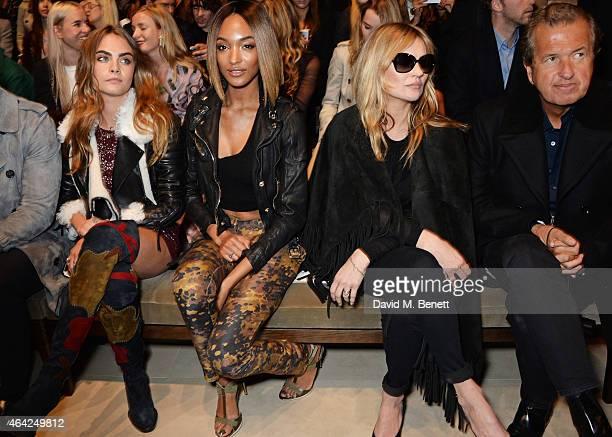 Cara Delevingne, Jourdan Dunn, Kate Moss and Mario Testino attend the Burberry Prorsum AW 2015 show during London Fashion Week at Kensington Gardens...