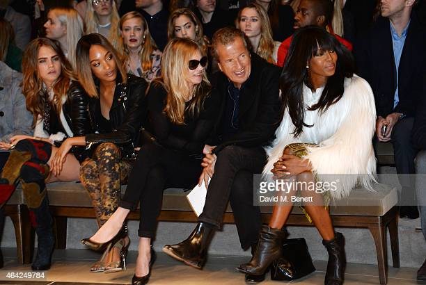 Cara Delevingne Jourdan Dunn Kate Moss Mario Testino and Naomi Campbell attend the Burberry Prorsum AW 2015 show during London Fashion Week at...