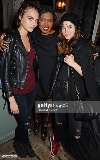 Cara Delevingne Lauryn Hill and Suki Waterhouse attend as Lauryn Hill performs at the Dover Street Arts Club on September 27 2014 in London England