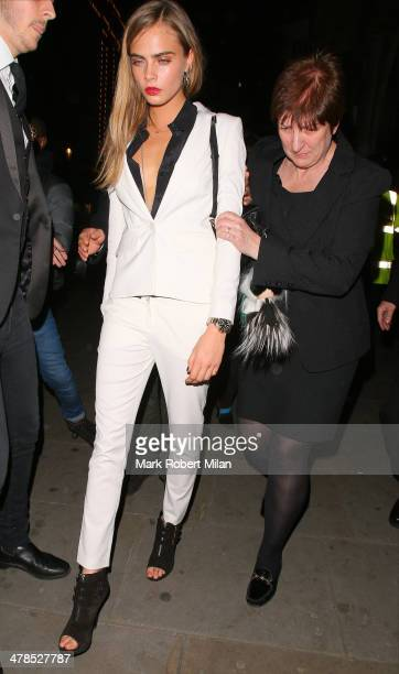 Cara Delevingne leaving the Karl Lagerfeld dinner at Harrods on March 13 2014 in London England