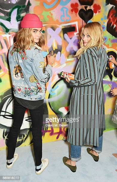 Cara Delevingne Margot Robbie and the cast of 'Suicide Squad' put the finishing touches on Graffiti artist Ryan Meades' mural ahead of tomorrow's...