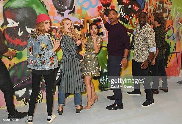 "Cara Delevingne, Margot Robbie, Karen Fukuhara, Will Smith, Adewale Akinnuoye-Agbaje, Jai Courtney and the cast of ""Suicide Squad"" put the finishing..."