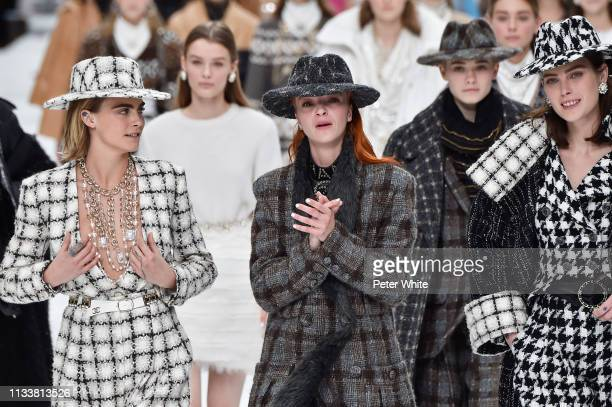 Cara Delevingne, Mariacarla Boscono and models walk the runway during the Chanel show as part of the Paris Fashion Week Womenswear Fall/Winter...