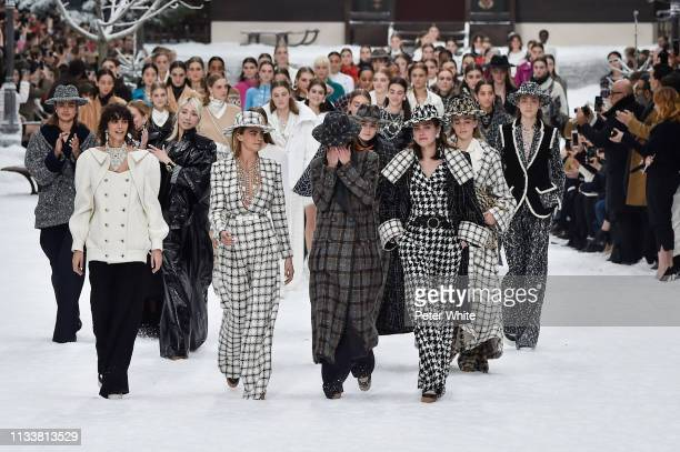 Cara Delevingne Mariacarla Boscono and models walk the runway during the Chanel show as part of the Paris Fashion Week Womenswear Fall/Winter...